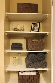 diy organizing open shelving in a bathroom for the home