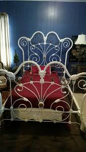 massive ornate white cast iron bed for the home
