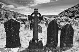grave stones celtic cross and gravestones in glendalough ireland photograph by