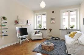 home decorating ideas on a budget with white sofa and round table home decorating ideas on a budget with white sofa and round table also fur rug gor small space design