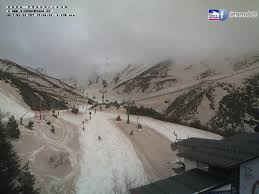 red snow after sand from sahara covers snowy sierra nevada spain