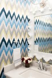yellow blue and gray chevron wallpaper in powder room
