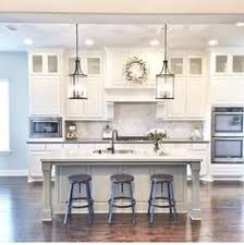 white kitchen with island kitchen with white cabinets and light blue island pinned to