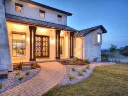 hill country home designs with stone walls and small transparent
