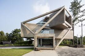 moon hoon uses diagonal beams to brace stacked box house on jeju