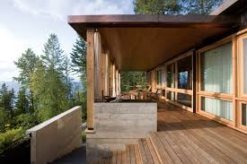 Decks With Roofs Pictures by Lakeside Retreat Showcases Rugged Natural Materials In Montana