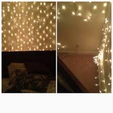 lights strung black sheer curtain it would be pretty to