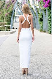white maxi dress with high slit and open back
