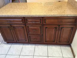 merlot cherry kitchen cabinets with quartz mitered edge