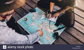 Map A Trip People Planning A Trip Around The World They Are Pointing On A