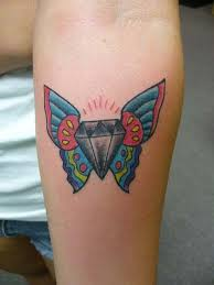 gray ink diamond with butterfly wings tattoo on leg