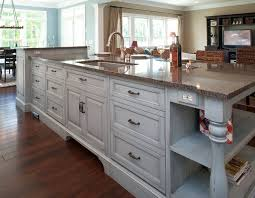 kitchen island with sink and dishwasher and seating luxury brown