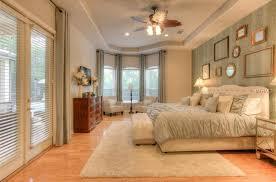 deco guest bedroom with carpet hardwood floors in ta fl