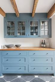 bright open kitchen with light blue cabinets butcher block
