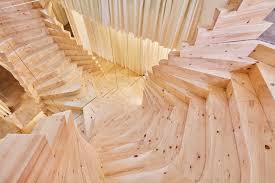 acme u0027s wildly twisting wooden staircase draws inspiration from