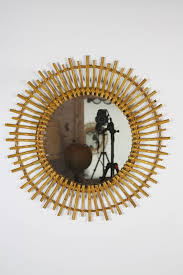 spanish bamboo and rattan sunburst mirror with curved beams for