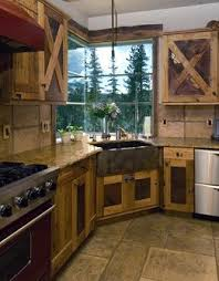 barn door style kitchen cabinets i really love this kitchen the copper apron sink the cabinets