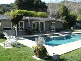 exterior luxury backyard decoration with bay area pools design