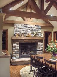 stacked stone fireplace ideas brown wooden laminate flooring
