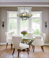 ball shaped iron chandelier and elegant white chairs for formal