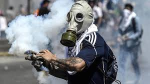 Gas Mask Costume Venezuela Crisis Protesters Make Creative Gas Masks For Street