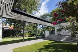 pre war house has brick volumes connected by bridges and gardens