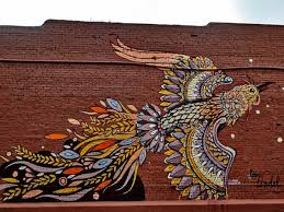 your guide to atlanta public art 29 works to see right now of living walls newer additions a stunning bird by atlanta artist john tindel whose work is inspired by both his background in design and illustration