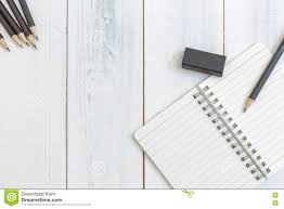 Wooden Table Top View Notebook Pencil And Eraser On Wooden Table Top View Concept Of