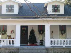 lighted christmas wreaths for windows exterior christmas decorating wreath on each window and spotlights