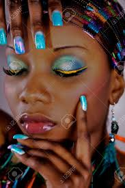 dark skinned woman with airbrush nails stock photo picture and