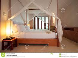 sleeping room with four poster bed stock photo image 35521036