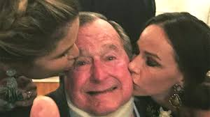 george h w bush gets sweet kisses from granddaughters in new