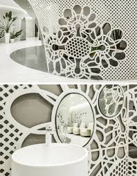 delicate patterns adorn the walls of this bright nail salon