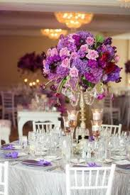 purple wedding centerpieces chic gold aqua and lavender wedding table numbers
