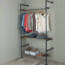 garment racks made with pipe and fittings give an industrial feel