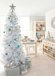 White Christmas Tree With Orange Decorations by Retro Holiday 10 Beautiful White Christmas Trees Apartment Therapy