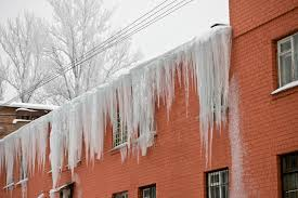 how to prevent damage from ice dams on historic brick homes