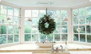 wreath and ornaments in kitchen sink window holidays and