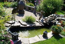 Backyard Pond Landscaping Ideas Garden Pond Landscape Ideas There Is A Fish Pond On Top Of The