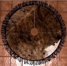 brown christmas tree skirt brindle leather cowhide christmas tree skirt with leather rosettes