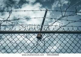 abstract chain link fence barbed wire stock photo 590108888