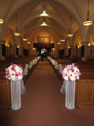 wedding flowers for church pedastals and frabic for the ceremony at church wedding