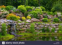 Small Rock Gardens by Rock Garden And Small Waterfall Knowlton Quebec Canada Stock