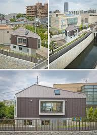 tiny triangular japanese house narrowly fits its little plot