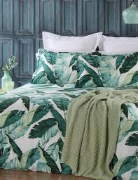 the florence duvet cover set features tropical leaves that create