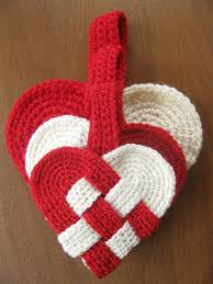 a danish heart made of two crocheted ovals woven together plus a