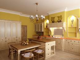 kitchen cabinet in yellow kitchen with chandelier lighting and