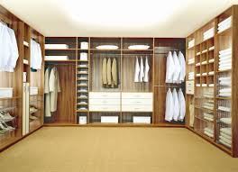 home interior wardrobe design large brown wooden cabinet with many shelves for clothes and shoes