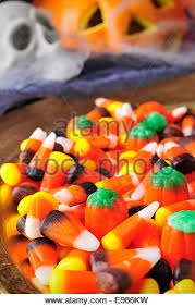 a pile of different candies with scary ornaments in the