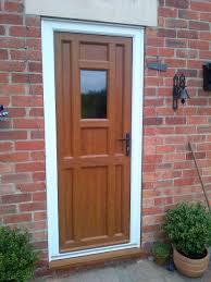 Upvc Barn Doors by Bespoke Upvc Front Door In Light Oak With Black Door Furniture